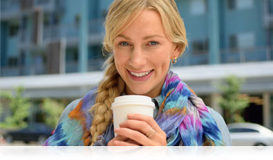 D5300 photo of a woman holding a coffee cup outdoors