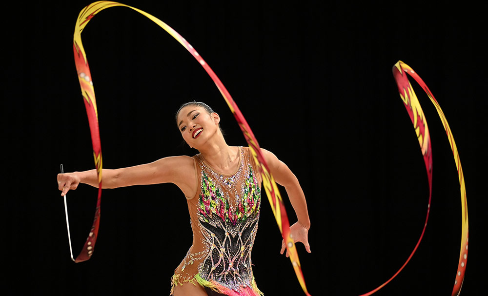 D6 DSLR photo of a rhythmic gymnast