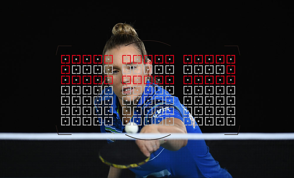 Photo of a table tennis player with the AF grid overlayed, taken with the D6 DSLR