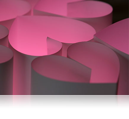 photo of paper hearts, lit underneath with a pink gel and illuminated by the SB700