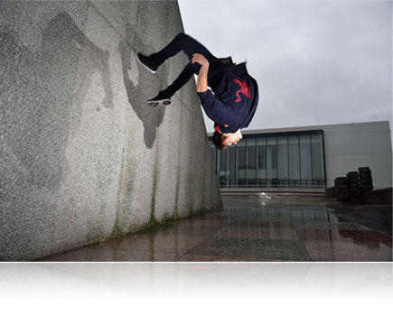 Nikon D750 photo of a male parkour athlete upside down in air, lit with the Nikon SB-500 Speedlight