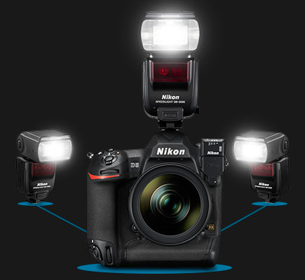 Photo of Nikon D5 DSLR with WR-R10/WR-A10 attached and three SB-5000 Speedlights