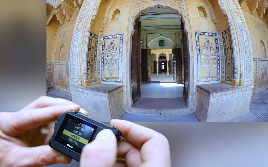 Photo of a building shot wide an extreme wide angle viewpoint, inset with hands holding the KeyMission 170