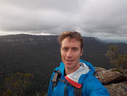 photo of a man taking a selfie (self portrait) outdoors