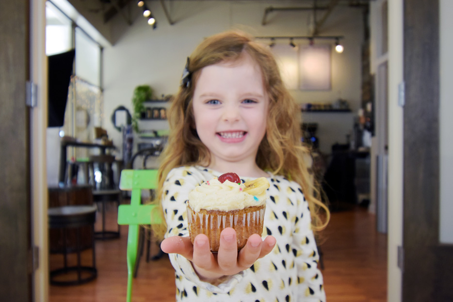 Photo of a girl holding a cupcake, shot with the AF-P DX NIKKOR 10-20mm f/4.5-5.6G VR lens