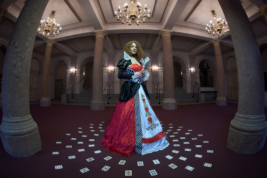 Photo of a woman with playing cards on the ground around her, shot with the AF-S Fisheye NIKKOR 8-15mm f/3.5-4.5E ED lens