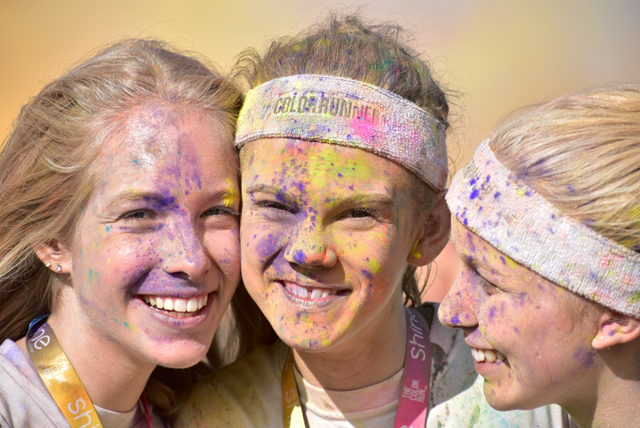 Photo of three women after a color run, taken with the AF-P DX NIKKOR 70-300mm f/4.5-6.3G ED VR lens