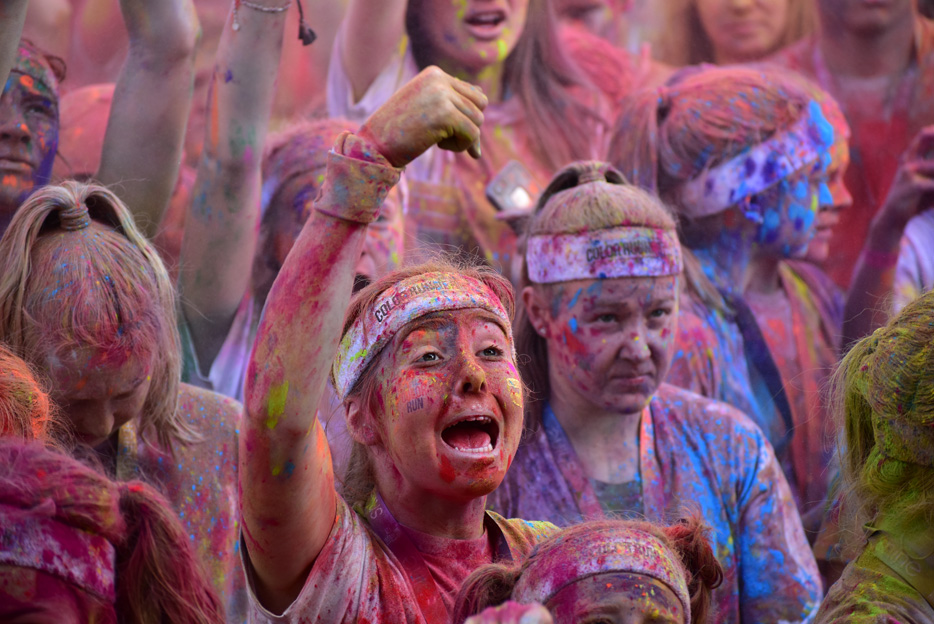 Photo of women covered in colored dust from a color run, taken with the AF-P DX NIKKOR 70-300mm f/4.5-6.3G ED VR lens
