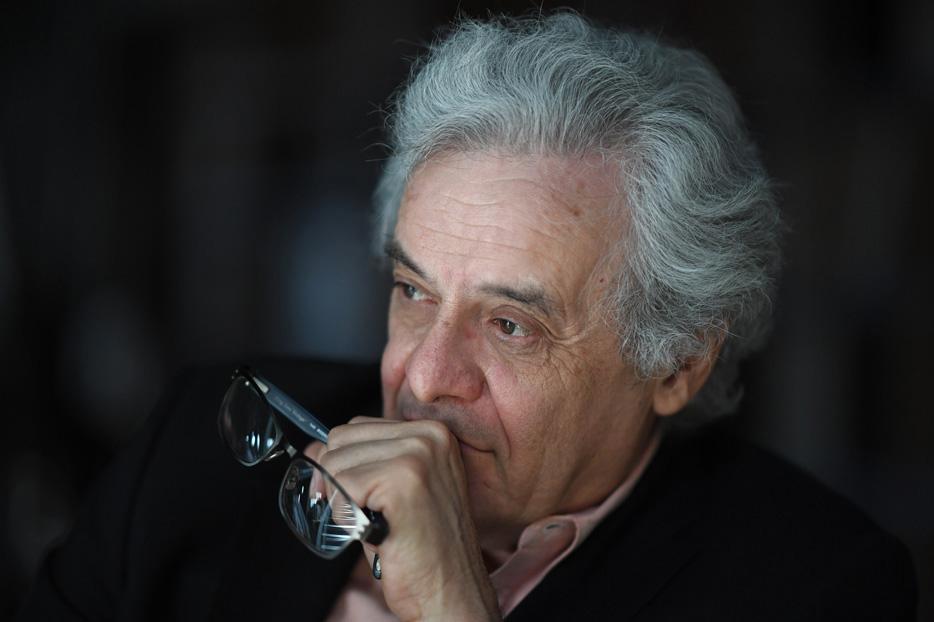 Portrait of an older man looking off camera, shot using the AF-S NIKKOR 105mm f/1.4E ED lens