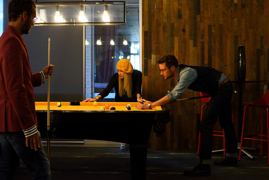 AF-S DX NIKKOR 35mm F1.8G photo of three people playing billiards