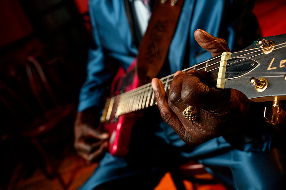 Photo of a musician's hands on a guitar, shot with the AF-S NIKKOR 35mm f/1.4G