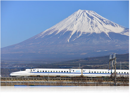 Photo taken with the AF-S NIKKOR 80-400mm f/4.5-5.6G ED VR of a bullet train in the foreground and mountain in the background