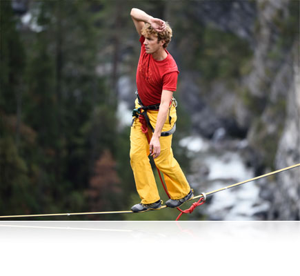 Photo of a tightrope walker over a gorge shot using the AF-S NIKKOR 300mm f/4E PF ED VR lens