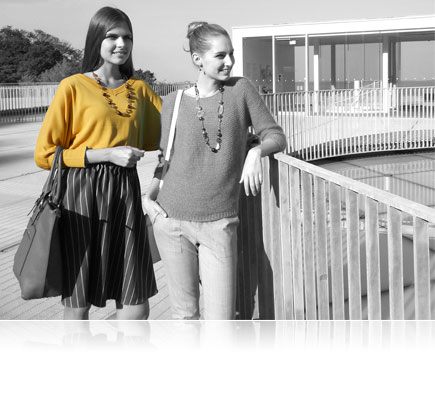 Selective color photo of two women, one with her shirt in yellow, the rest of the image in B&W, shot with the COOLPIX S3700