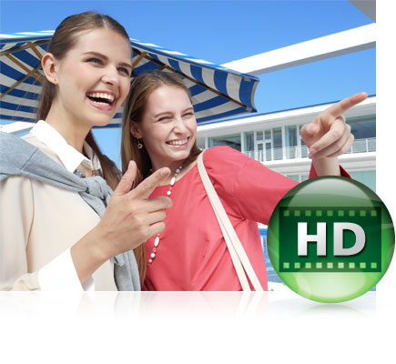 COOLPIX S3700 photo of two women smiling outdoors with a blue and white striped umbrella and house in the background