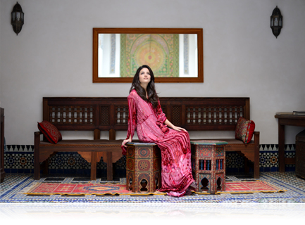 photo of a woman in a long red dress shot indoors