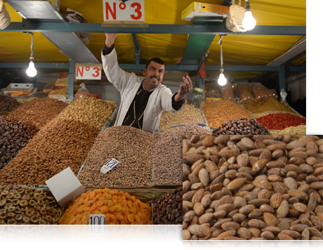 photo of a man selling nuts at a market, and a closeup view of nuts