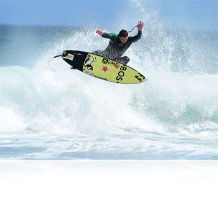 Photo of a surfer in air over a wave, shot with the AF-S NIKKOR 500mm f/4E FL ED VR lens