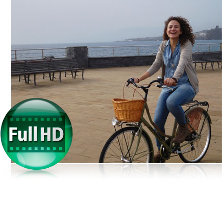 S7000 photo of a woman on a bicycle on a pier with water in the background