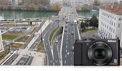 Photo of a city's roads from the air, inset with a photo of the S9900 camera