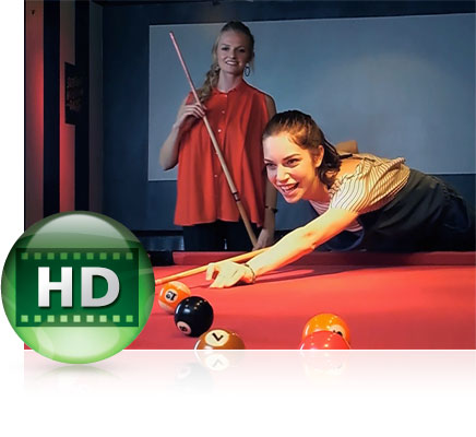 Photo of two women playing billiards and the HD video icon