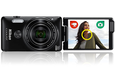 COOLPIX S6900 photo of a woman and the camera inset with selfie graphics on the LCD