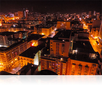 Low light photo of the roofs of buildings in a city