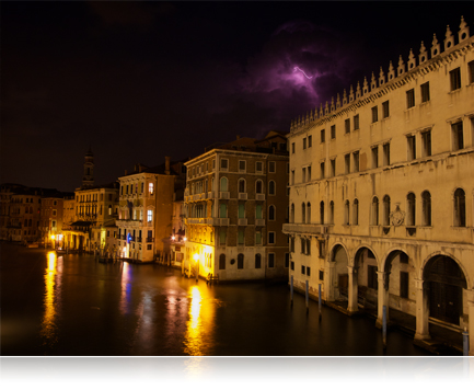 photo of buildings taken at night in Venice, Italy