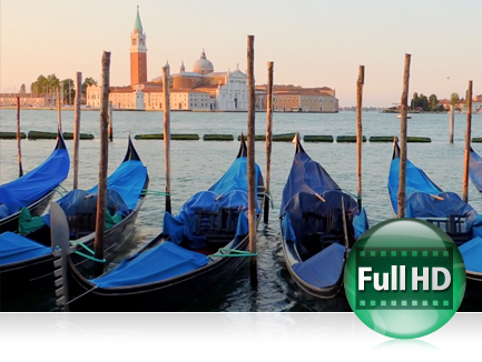 photo of blue tarp covered gondolas docked in Venice, Italy with a small island in the far background