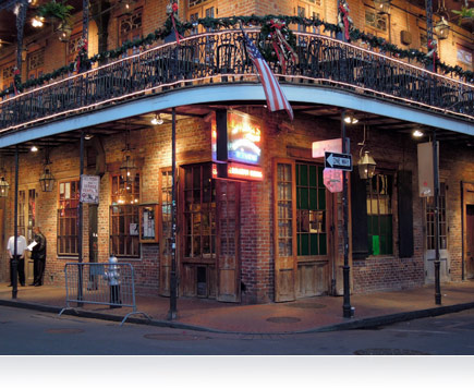Nighttime photo of a corner building in New Orleans, Louisiana