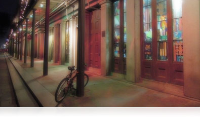 Nighttime Backlight HDR photo of storefronts on a New Orleans, Louisiana street