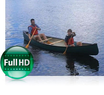 Photo of a dad and son canoeing with the Full HD video icon showing video capabilities