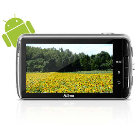 Photo of the rear LCD of the camera showing a landscape photo  that features a field of sunflowers and the Android robot