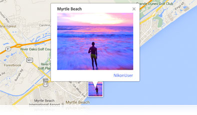 Photo of a person standing at the edge of the ocean in Myrtle Beach over a map showing built-in GPS functionality