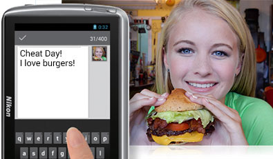 Photo of a woman with a hamburger and a smartphone showing the photo and a comment
