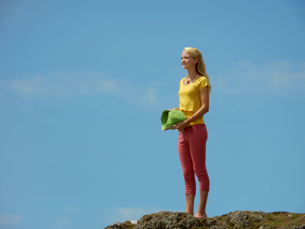 12x Optical zoom photo of a woman standing on a hill, showing the zoom range of the COOLPIX S810c