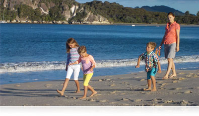 Photo of a family walking on the beach, showing sharp photos of moving subjects