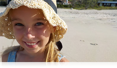 close up portrait of a girl on the beach, looking into the camera highlighting the Smart Portrait System