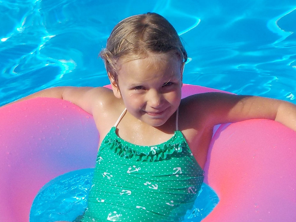 Tight shot of a girl on a floating ring in a pool showing the zoom range of the S32