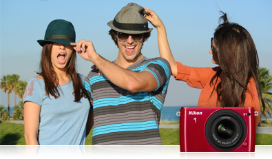 photo of man and two women near a beach, and product photo of the Nikon 1 S1
