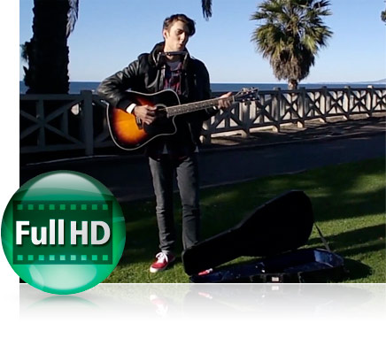 Photo of a guy outdoors in a park playing an acoustic guitar and the Full HD video icon