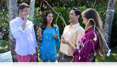Nikon 1 S2 photo of four adults outdoors with confetti
