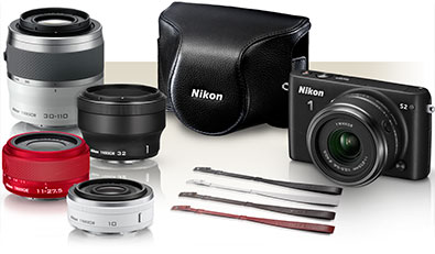 Photo of the Nikon 1 S2 and accessories including four lenses, case and straps
