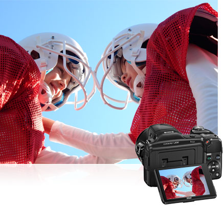 Closeup photo of two boys in football gear inset with the COOLPIX L830 and its LCD