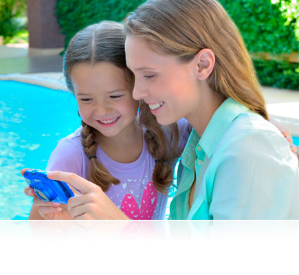 Photo of a mom and daughter poolside, with the blue S33 in hand, looking at the LCD
