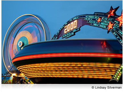 Photo of a carnival ride in motion at night, taken with the AF-S NIKKOR 24-85mm f/3.5-4.5G ED VR lens.