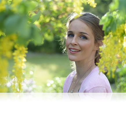 Nikon 1 J5 photo of a woman in a park among green trees