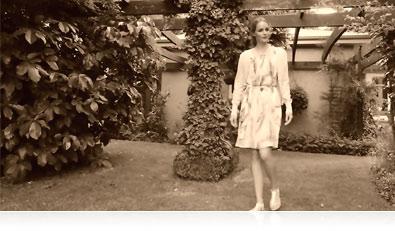 Nikon 1 J5 photo of a woman in a garden, in sepia