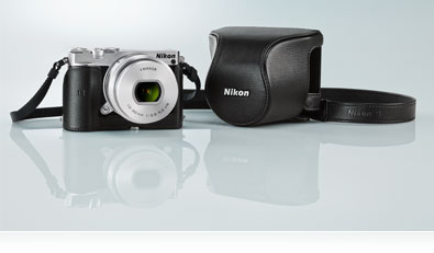 Photo of the silver Nikon 1 J5, lens and black case