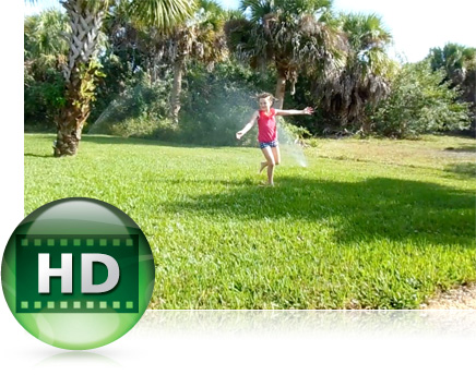 Photo of a kid playing in a sprinkler in a garden with the HD video graphic icon